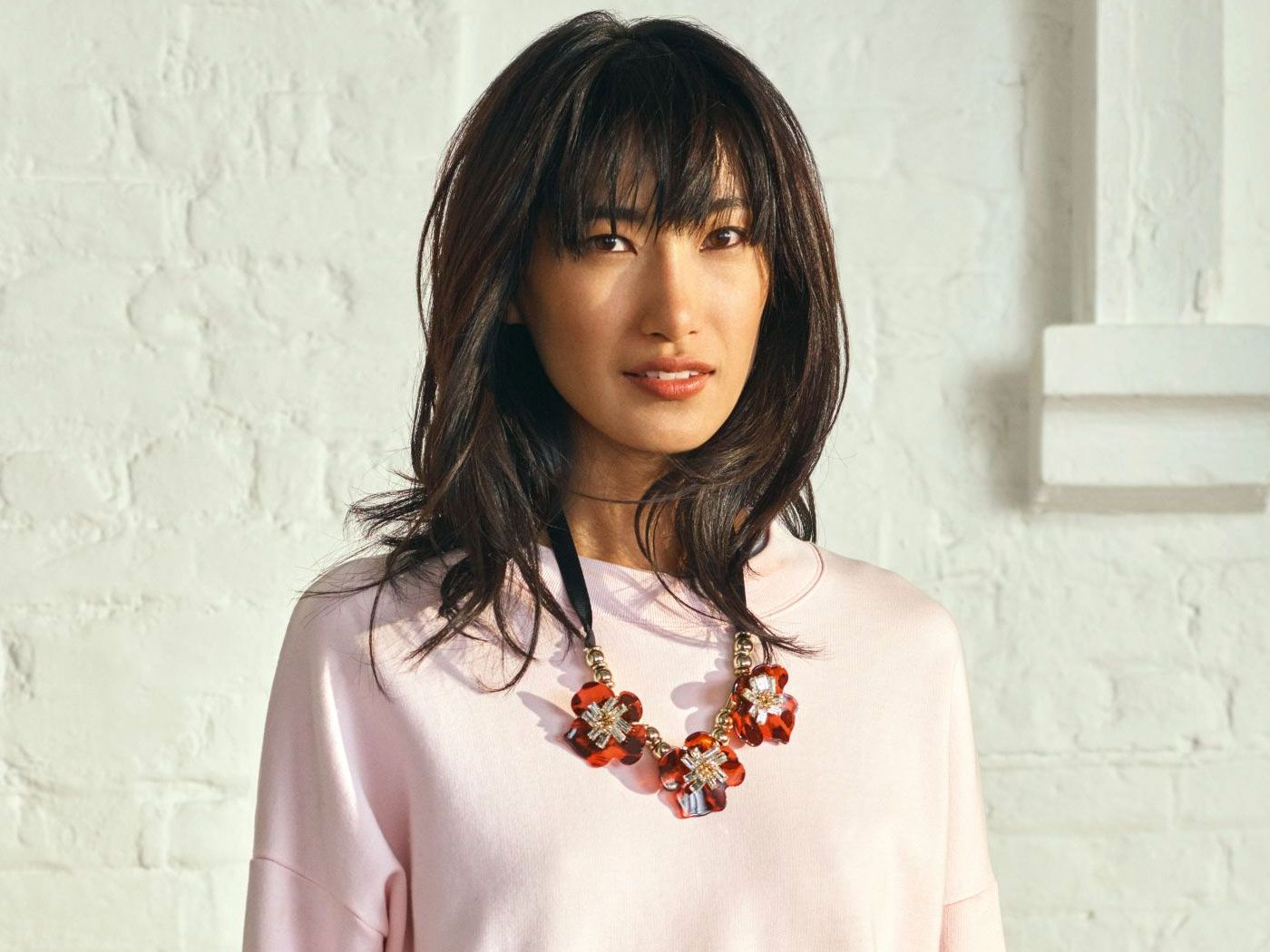 A model wearing a bold statement necklace from fashion retailer John Lewis