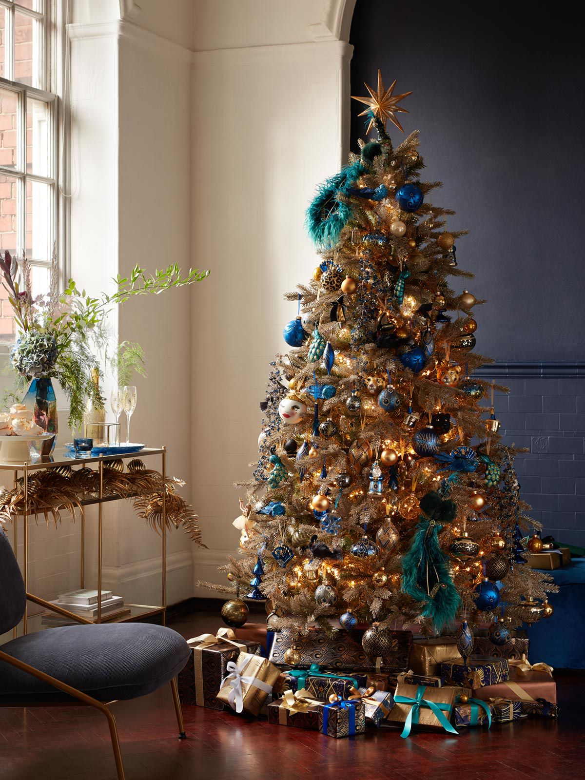 Beautiful Christmas tree decorated with opulent, art-nouveau inspired baubles and ornaments
