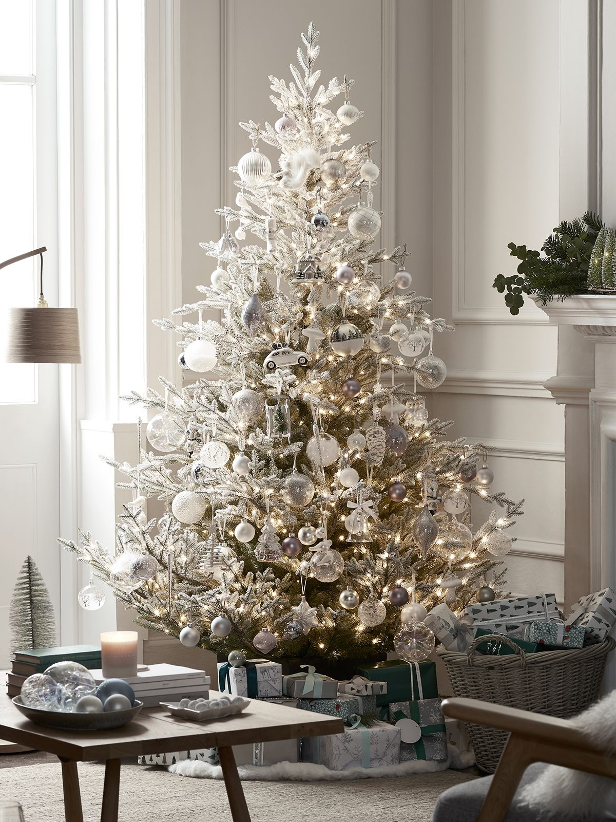 Beautiful Christmas tree decorated with white and silver baubles