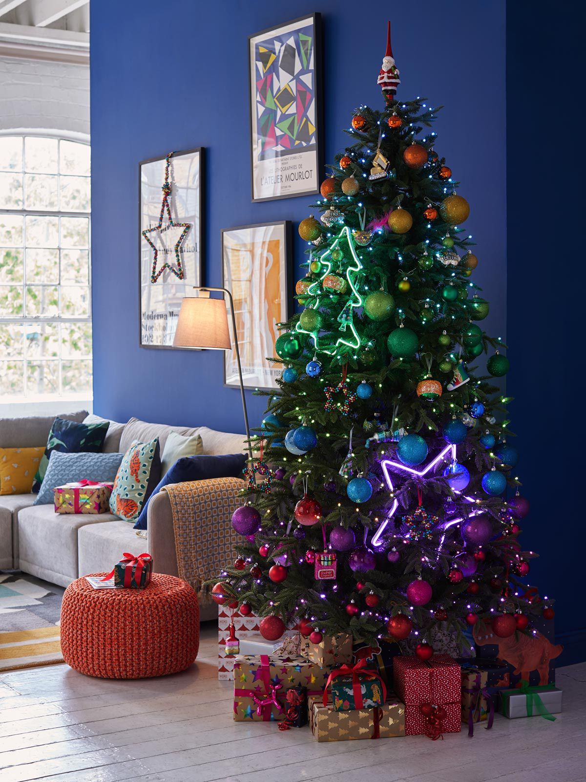 Beautiful Christmas tree decorated with colourful, Pop Art inspired baubles and ornaments