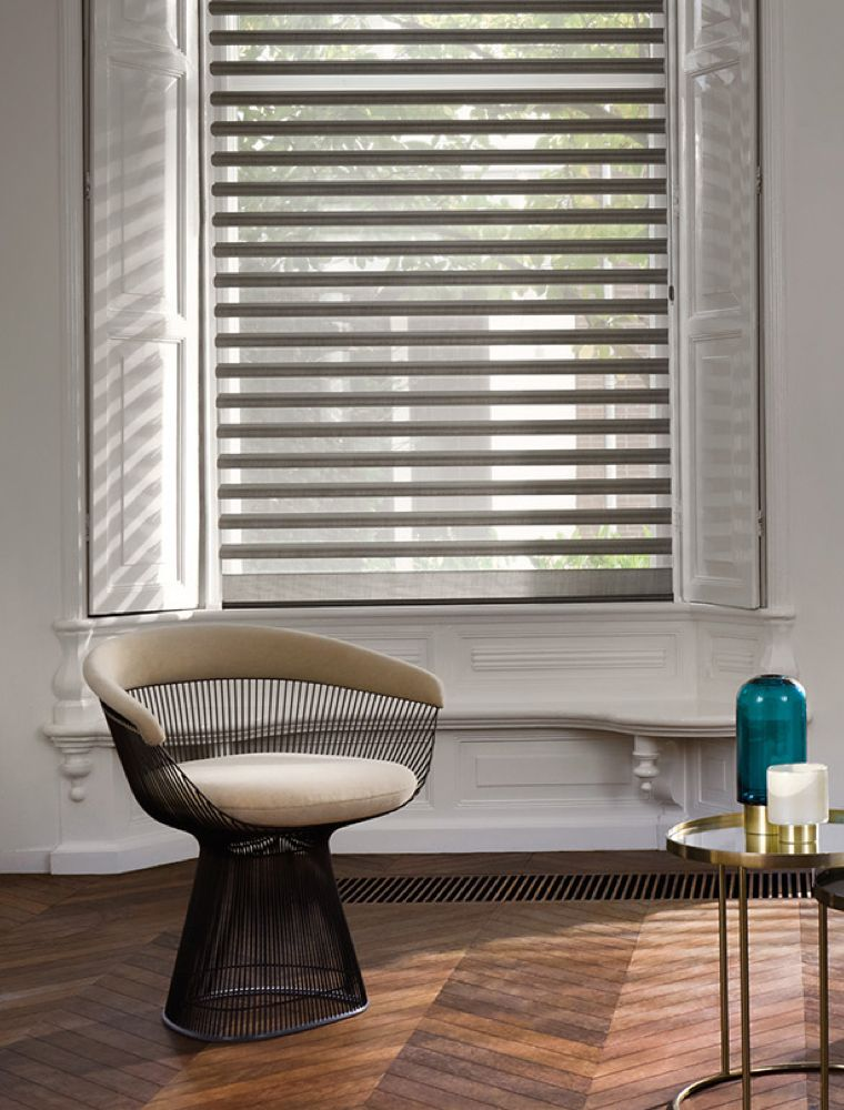 Stylish living room with specialist fitted blinds at the windows