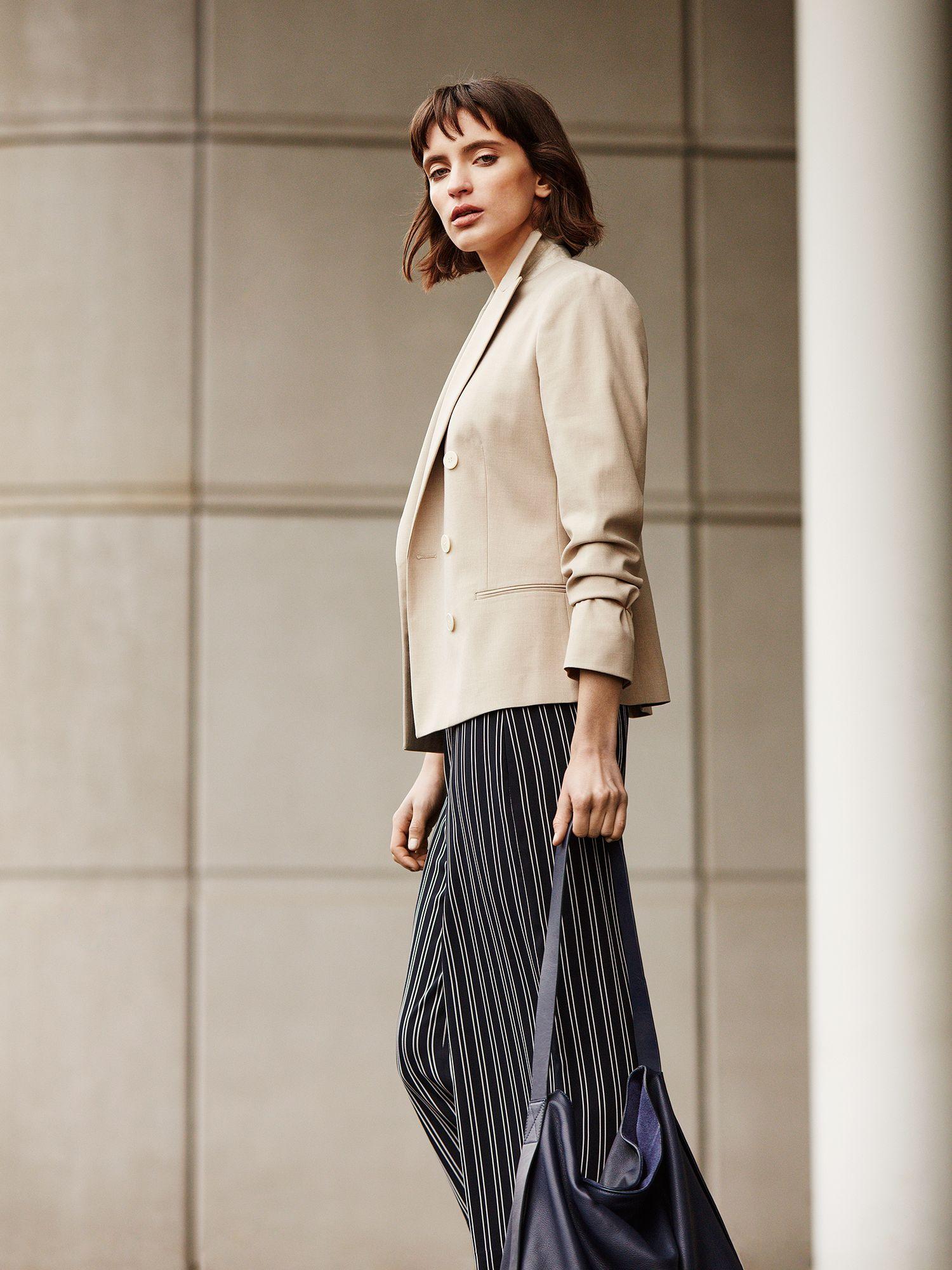 woman wearing a blazer and palazzo pants