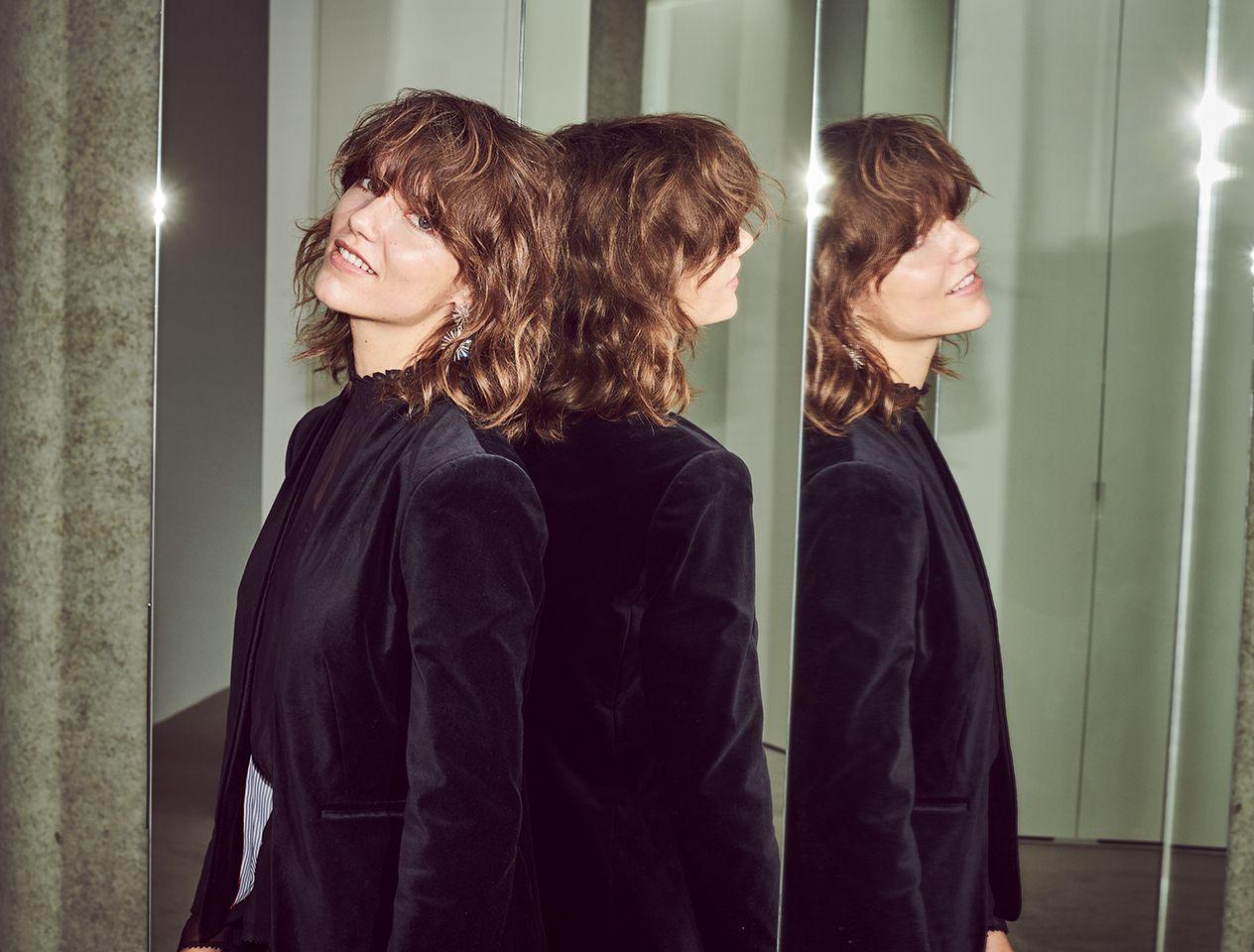 Model wearing a velvet jacket