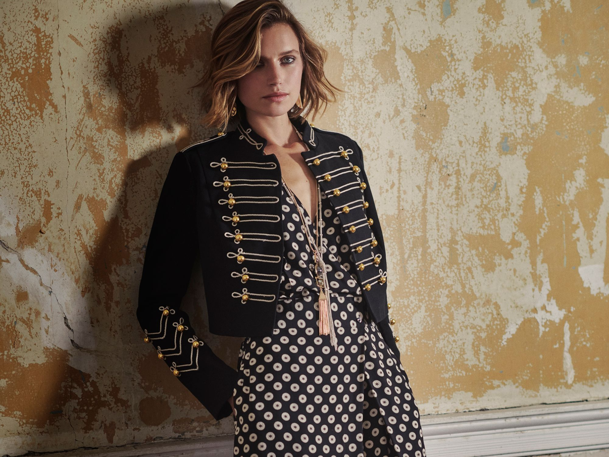 A fashion model wearing a military jacket and jumpsuit from Somerset by Alice Temperley for John Lewis