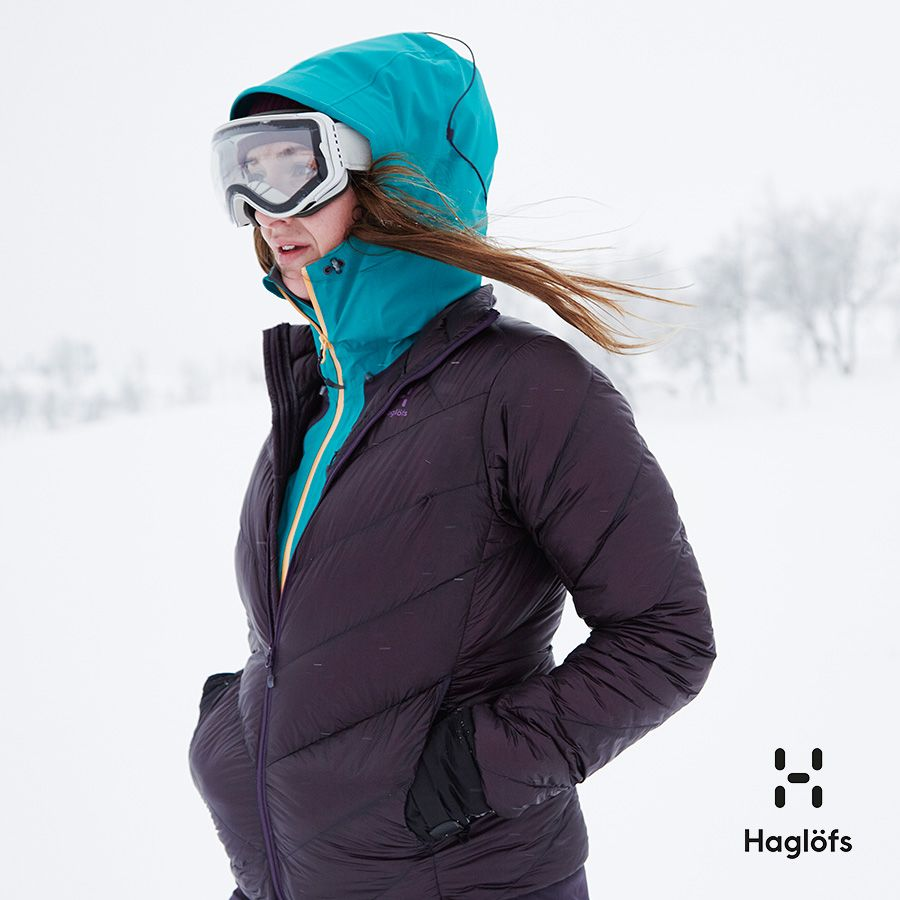 Haglöfs model in quilted jacket