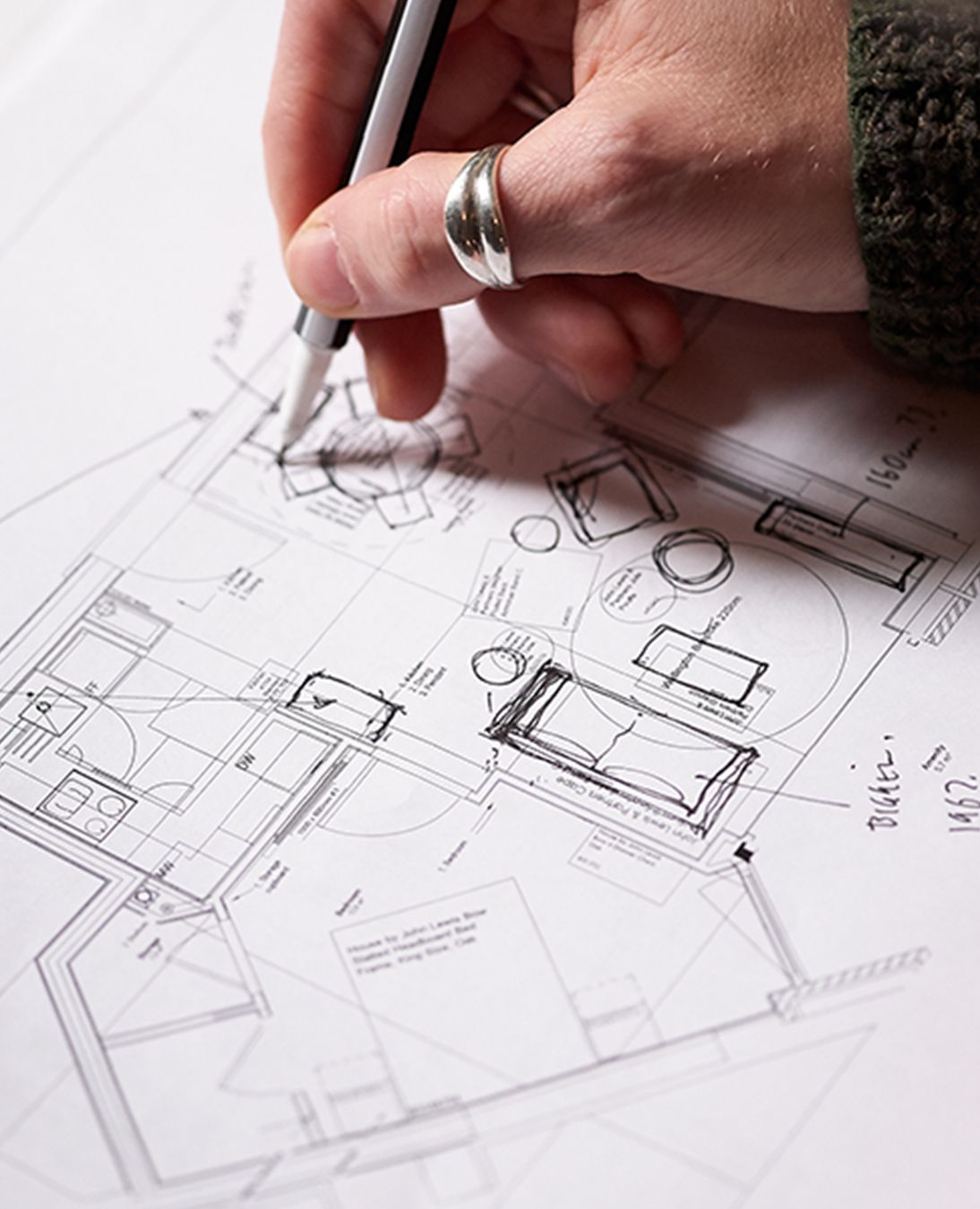 JLP-Business-Stanhope-Image-Block-2-Close-up hand making notes on floor plans