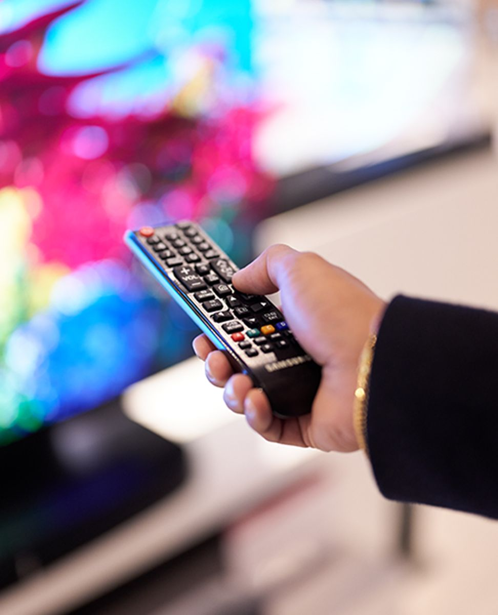 Remote control pointing toward large tv screen - in the in-store Technology department