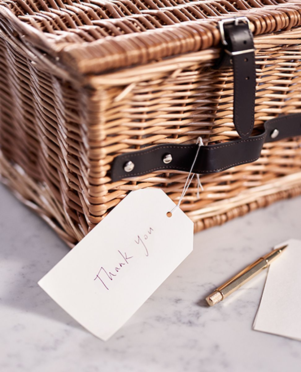 Close up photograph  of a closed hamper gift set and handwritten thank you card