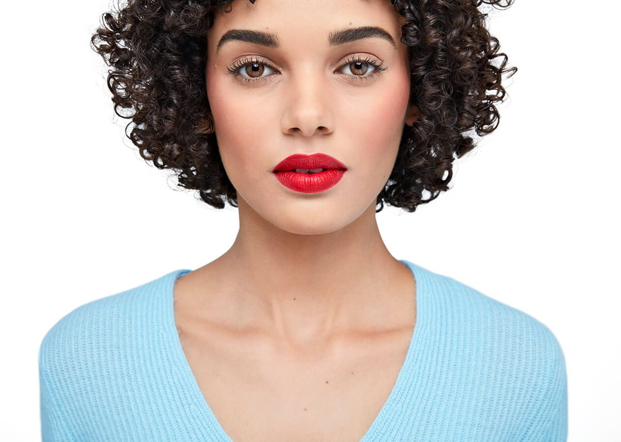 Model with bold red lipstick