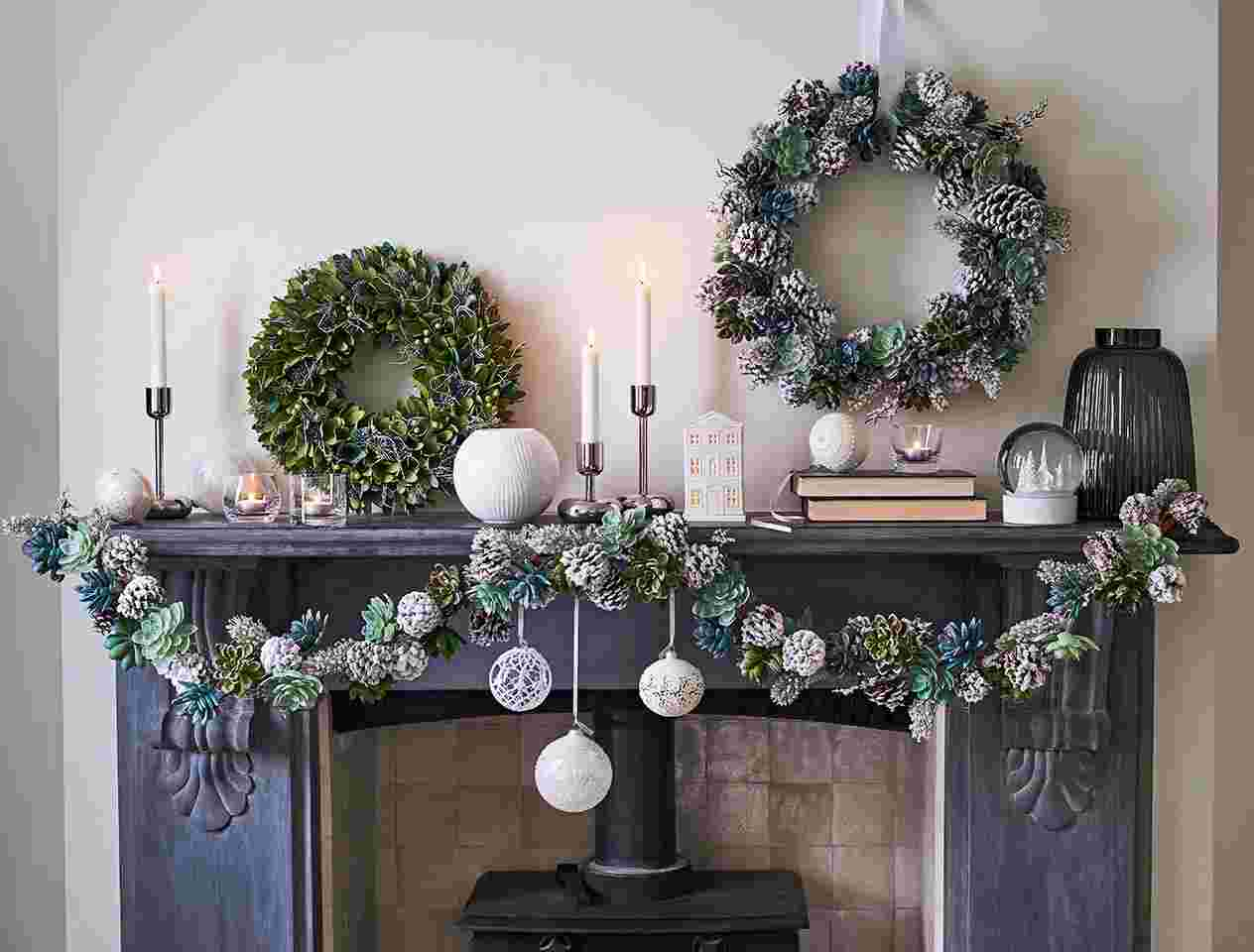 Fireplace decorated with Christmas baubles and wreaths
