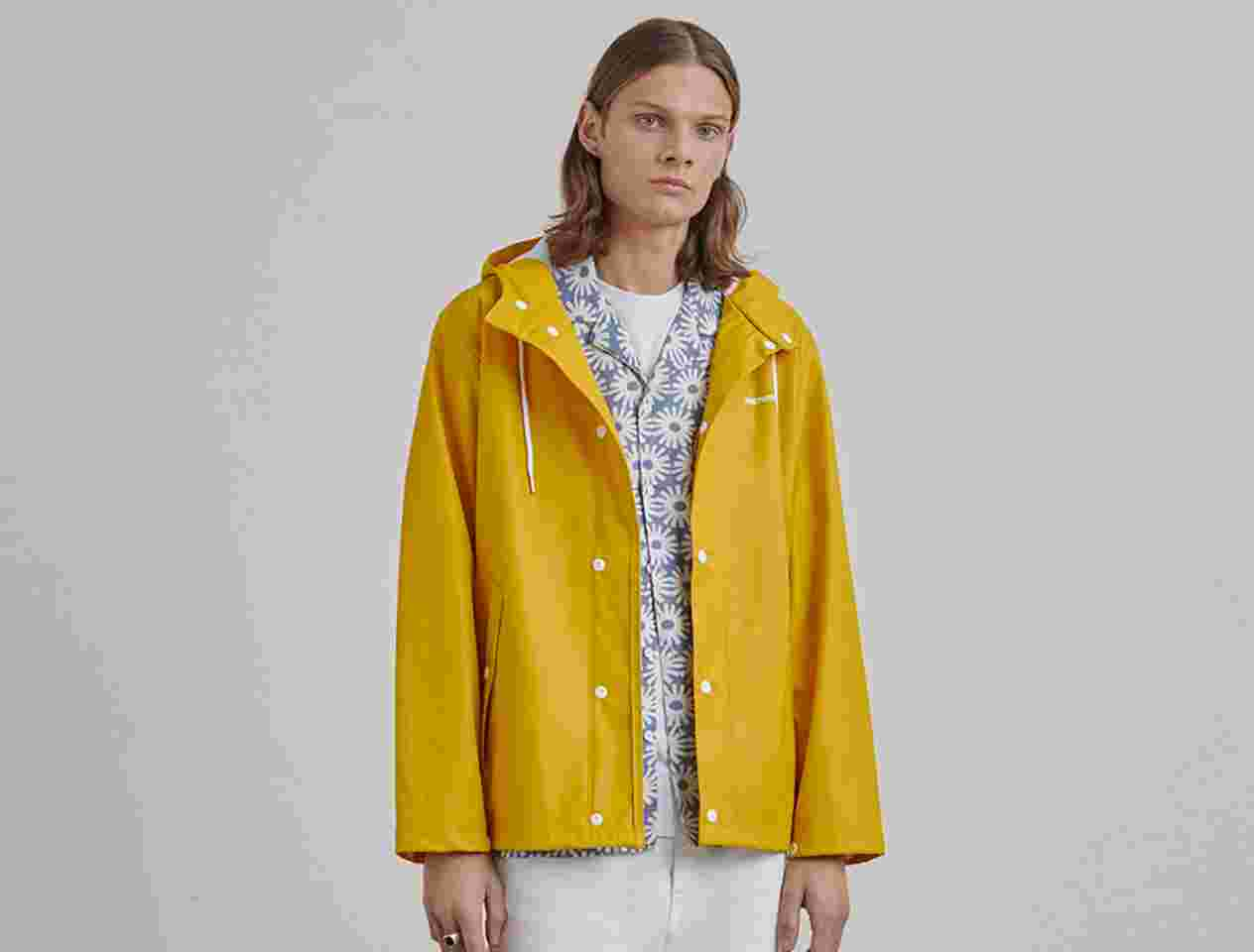 Model in Tretorn yellow jacket