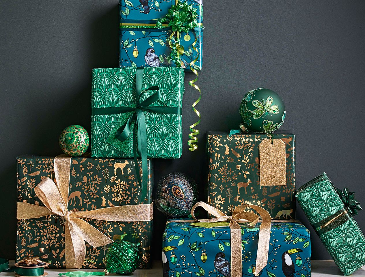 Green gift-wrapped Christmas presents