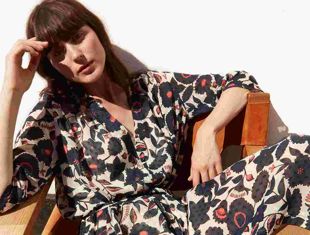Just Female model in a floral dress