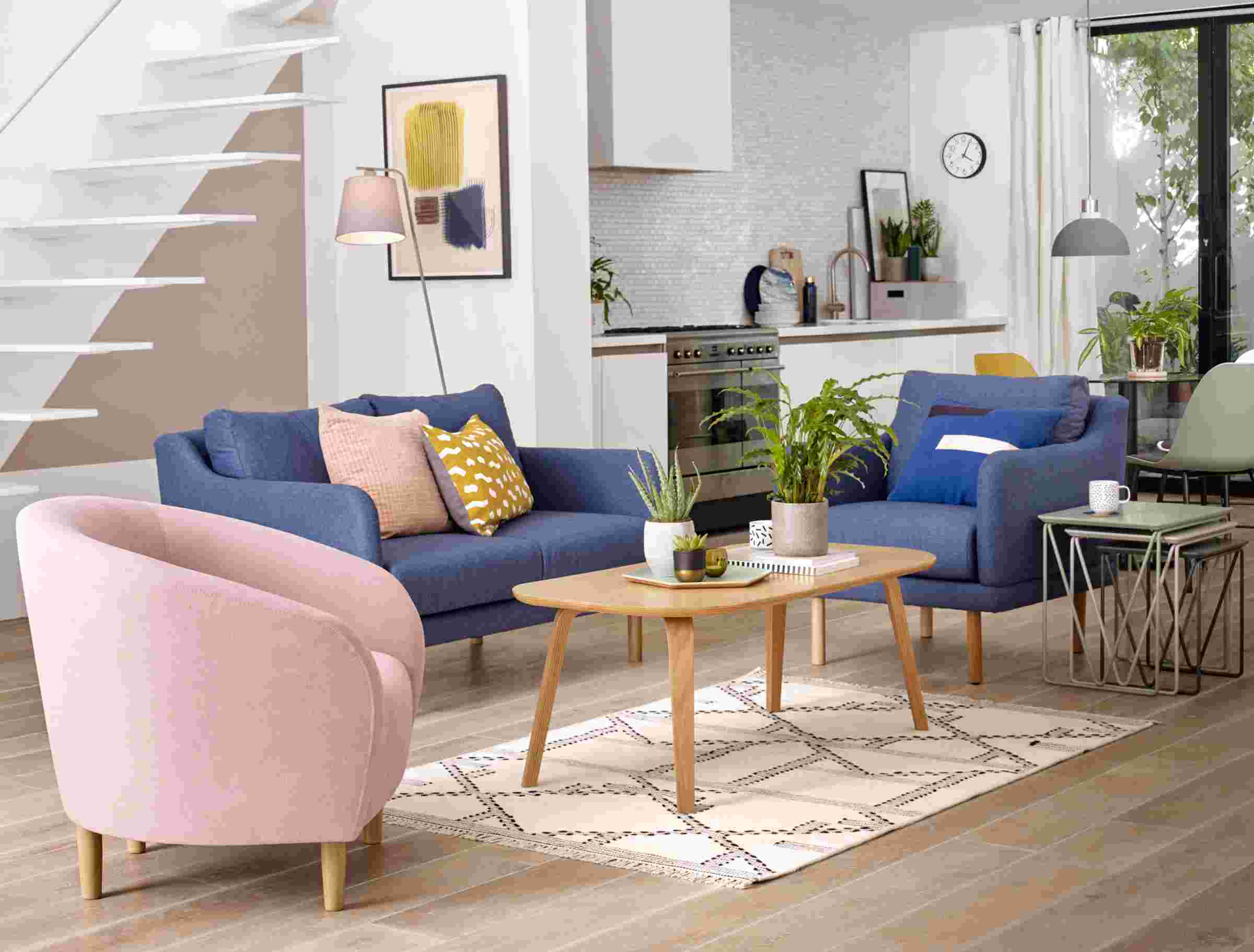 Living room with pink and blue chairs