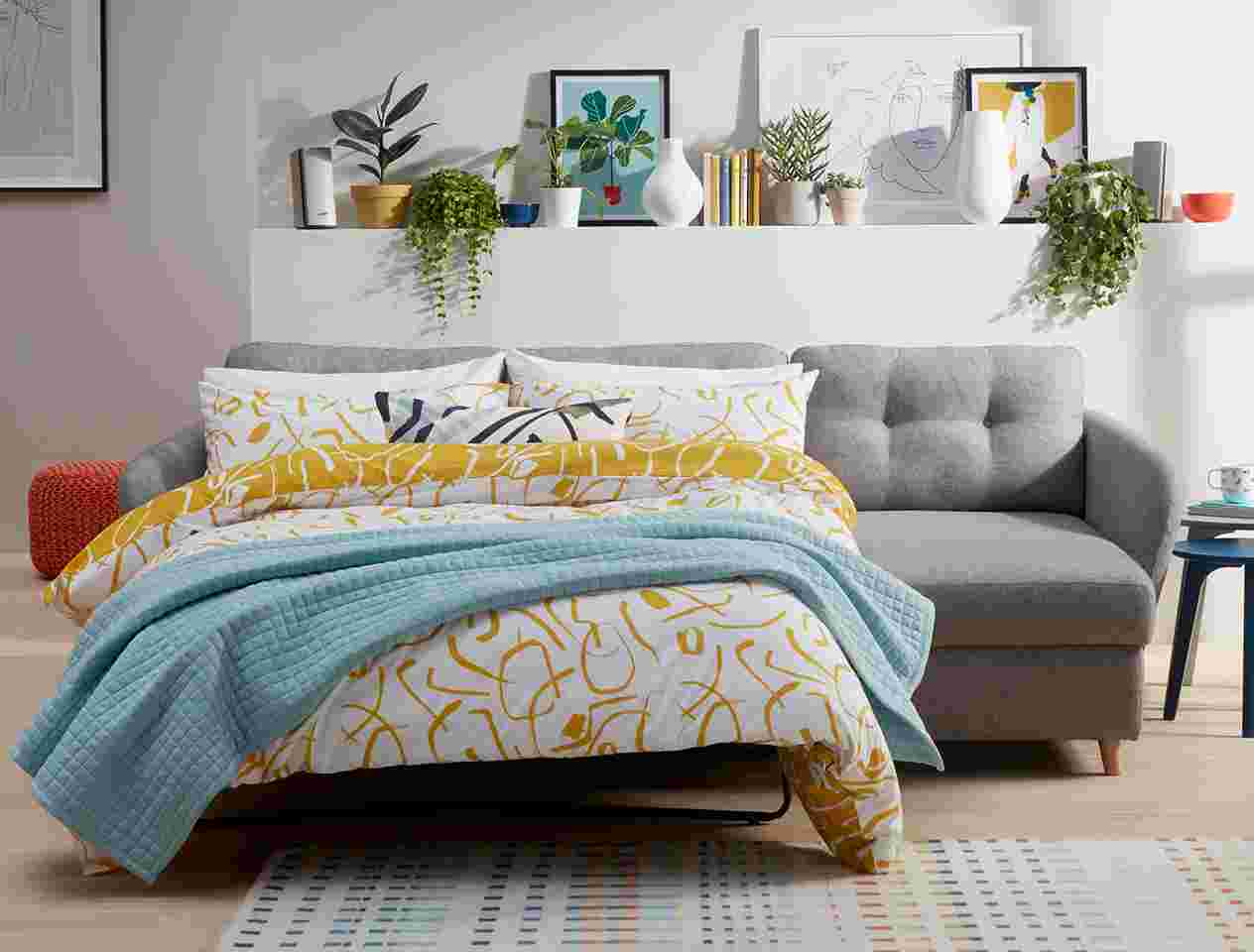 Sofa bed with bedding