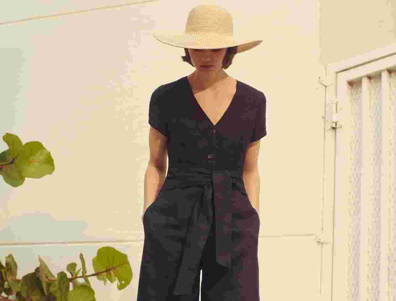 Model in blue linen jumpsuit