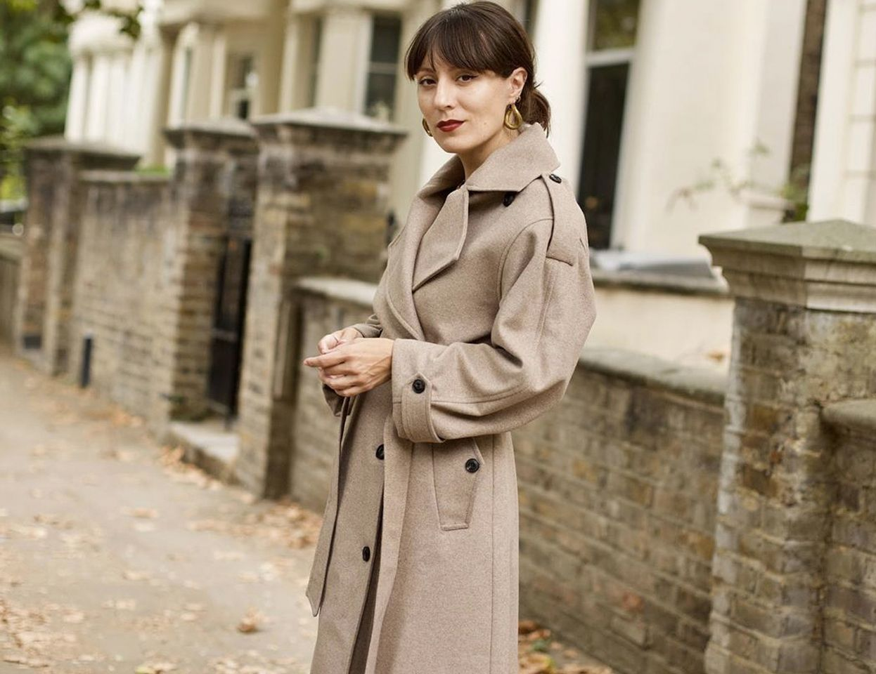 Katherine Ormerod in a camel coat by Modern Rarity