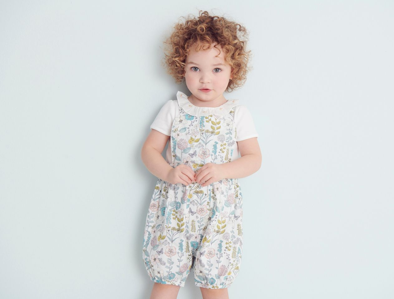 Toddler in romper suit