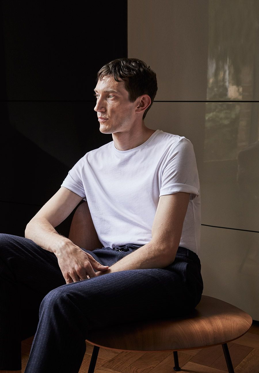 Man in a white t-shirt and blue trousers