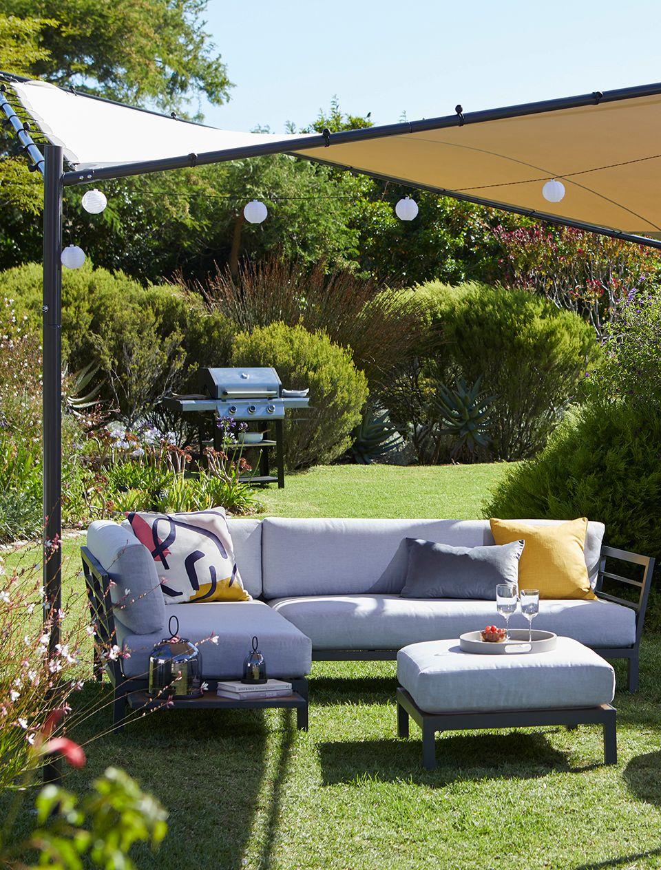 Sail in a garden with an outdoor sofa