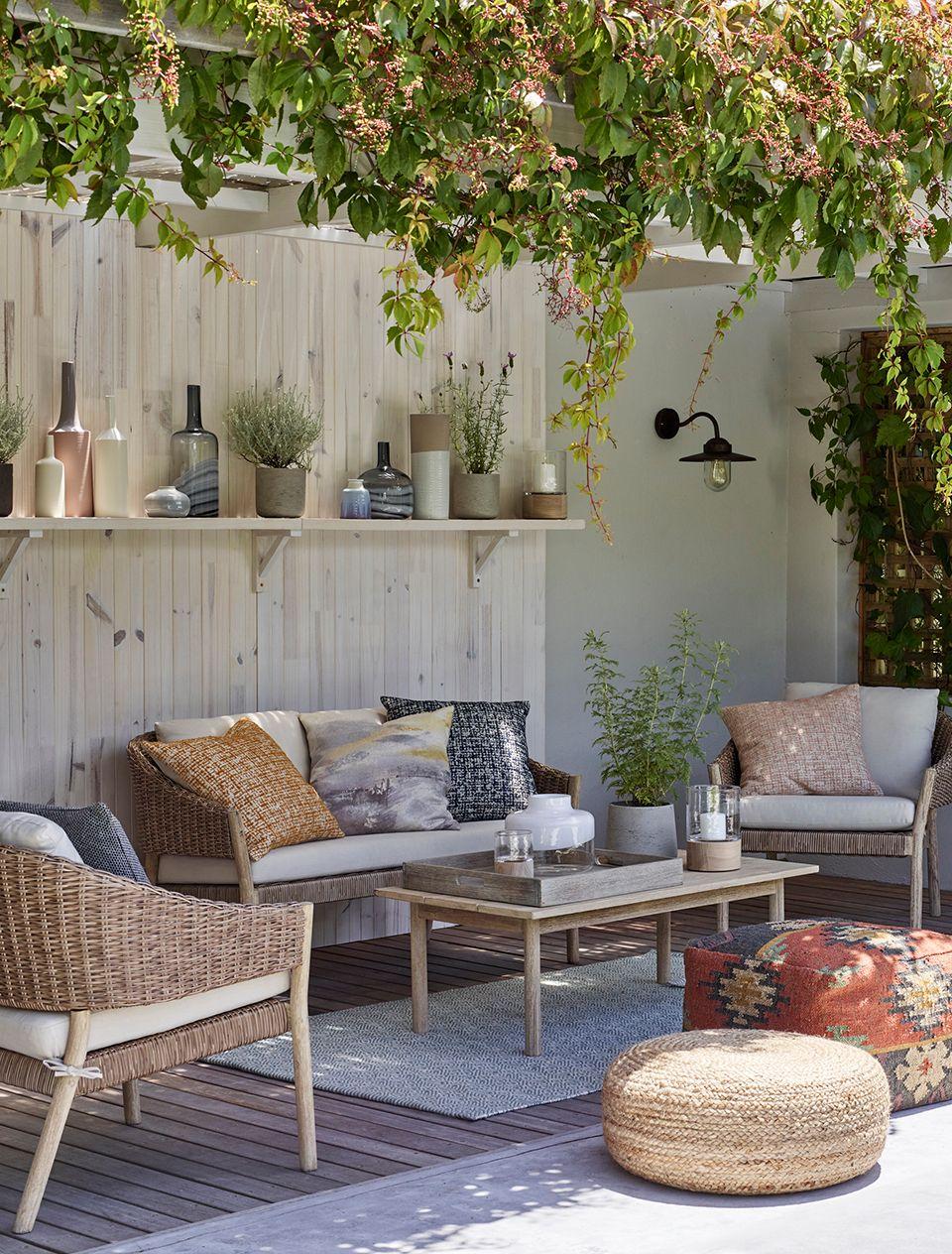 Garden sofa with plants
