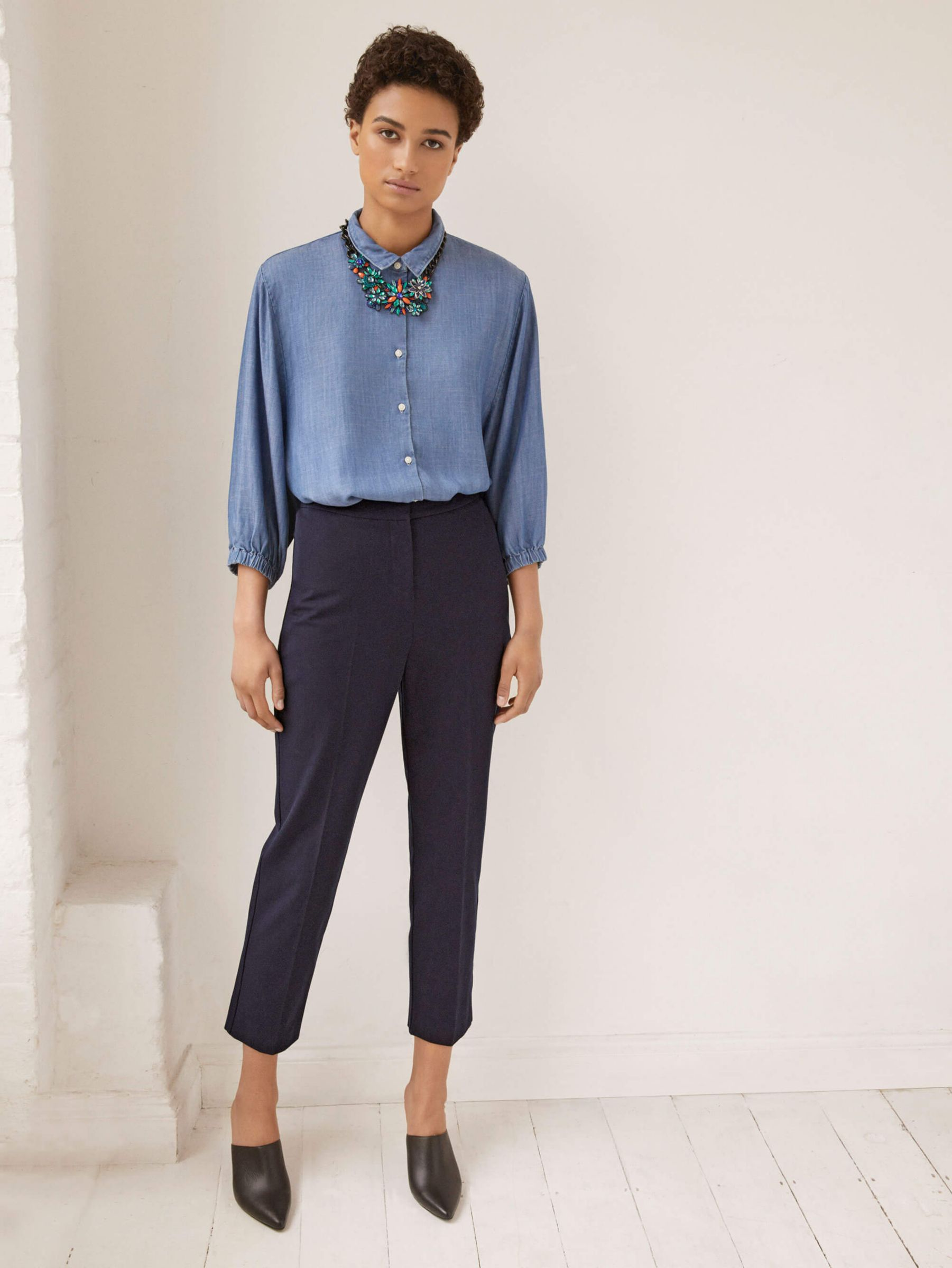 Woman in denim shirt and trousers