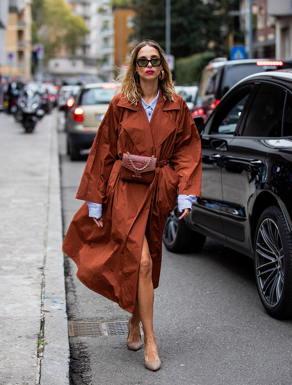 How to style a trench coat: swap a belt for a bum bag