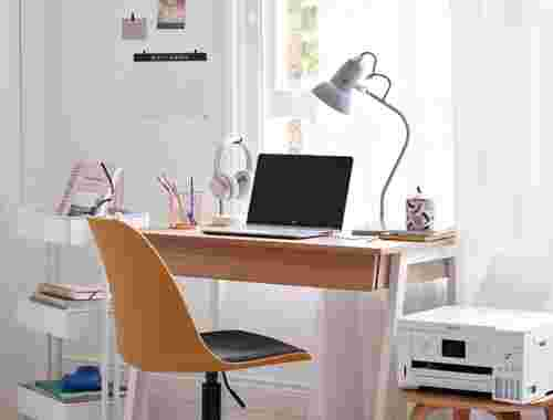 Desk with laptop and printer